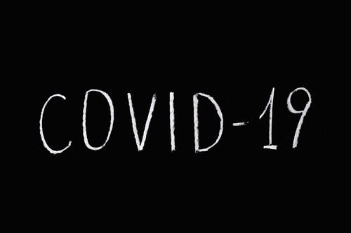 Covid-19 Lettering Text on Black Background