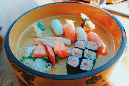 Delicious assorted sushi and rolls in bowl