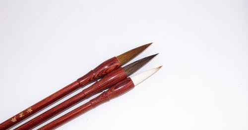 From above of set of professional Japanese calligraphy brush pens with bamboo shafts and soft tips