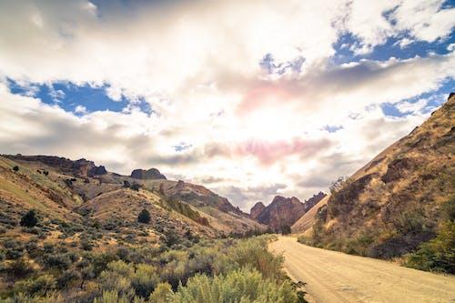 Sandy road among rocky hills