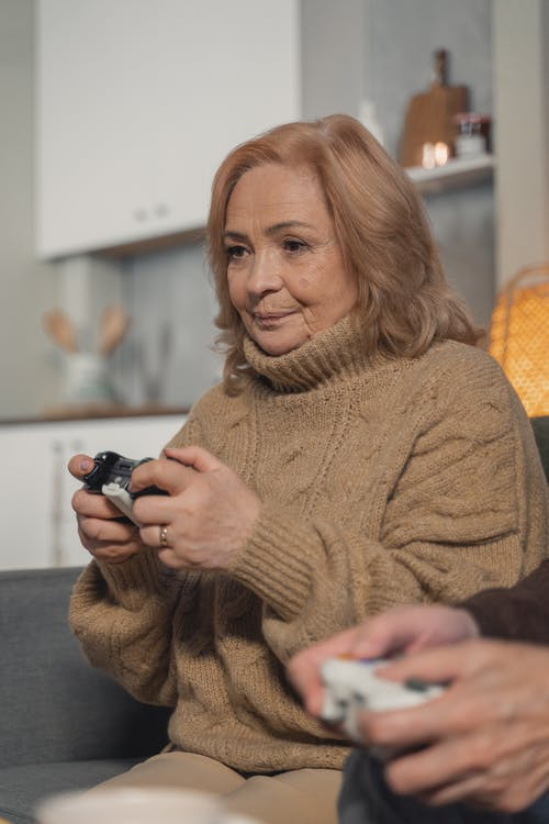 Elderly Woman Playing Video Games