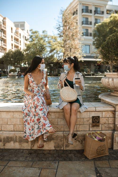 Women Sitting in The Water Fountain Wall