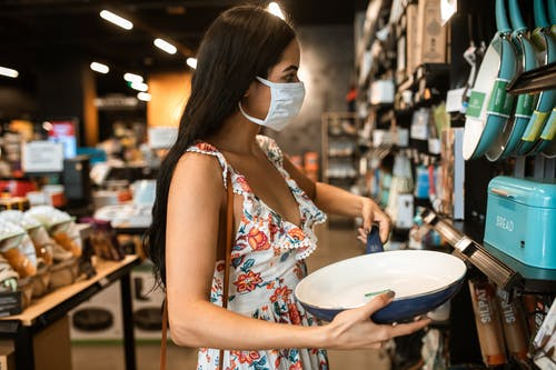Woman Checking On A Blue Cooking Pan