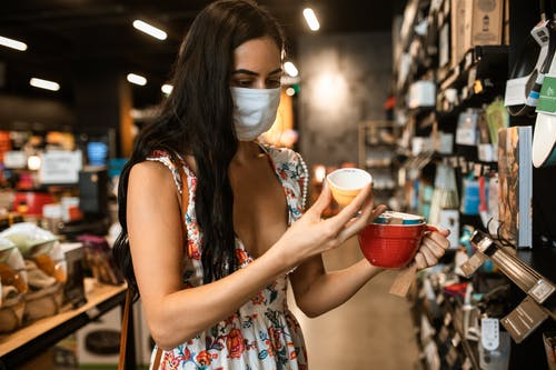 Woman in Floral Dress Holding A Ceramic Cup