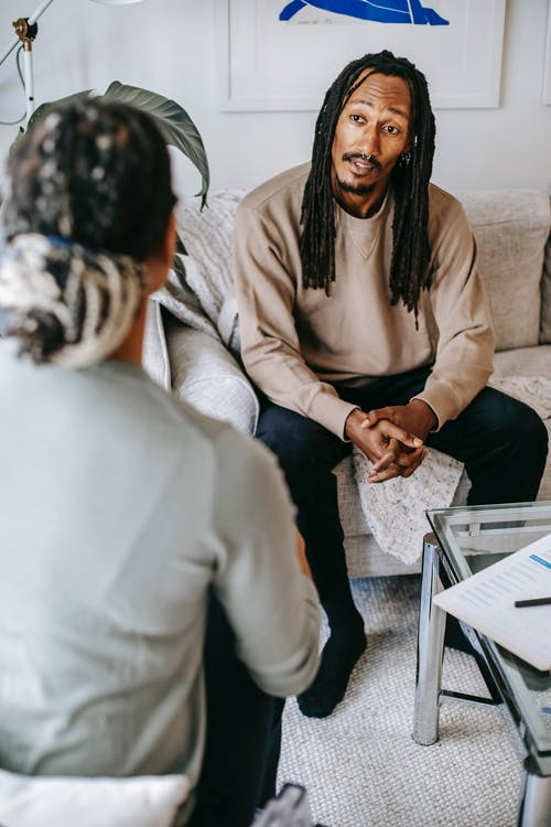 Black man explaining problem to female psychologist
