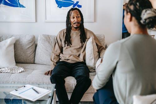 Black man having conversation with psychologist