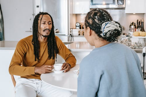 Black couple discussing problems in kitchen