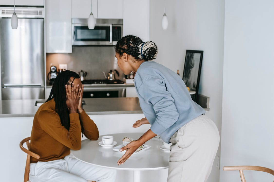 African American couple having conflict at kitchen