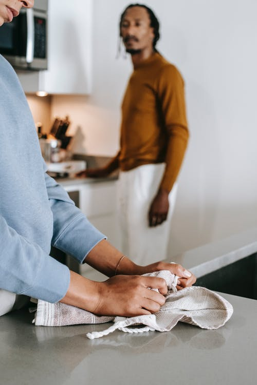African American couple having conflict while standing in kitchen in daylight and wearing casual outfit