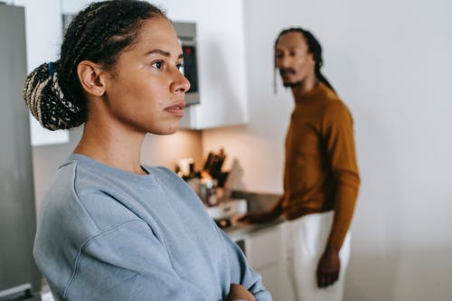 African American couple arguing at home