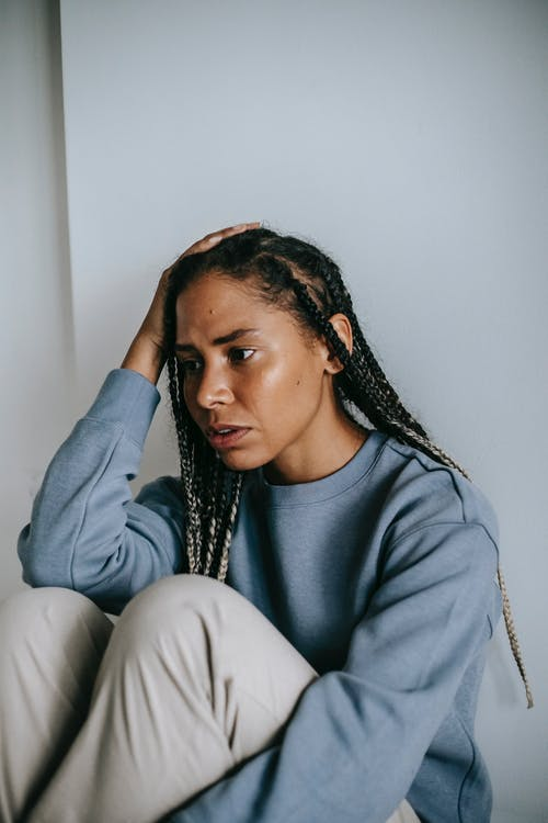 African American female sitting in room alone