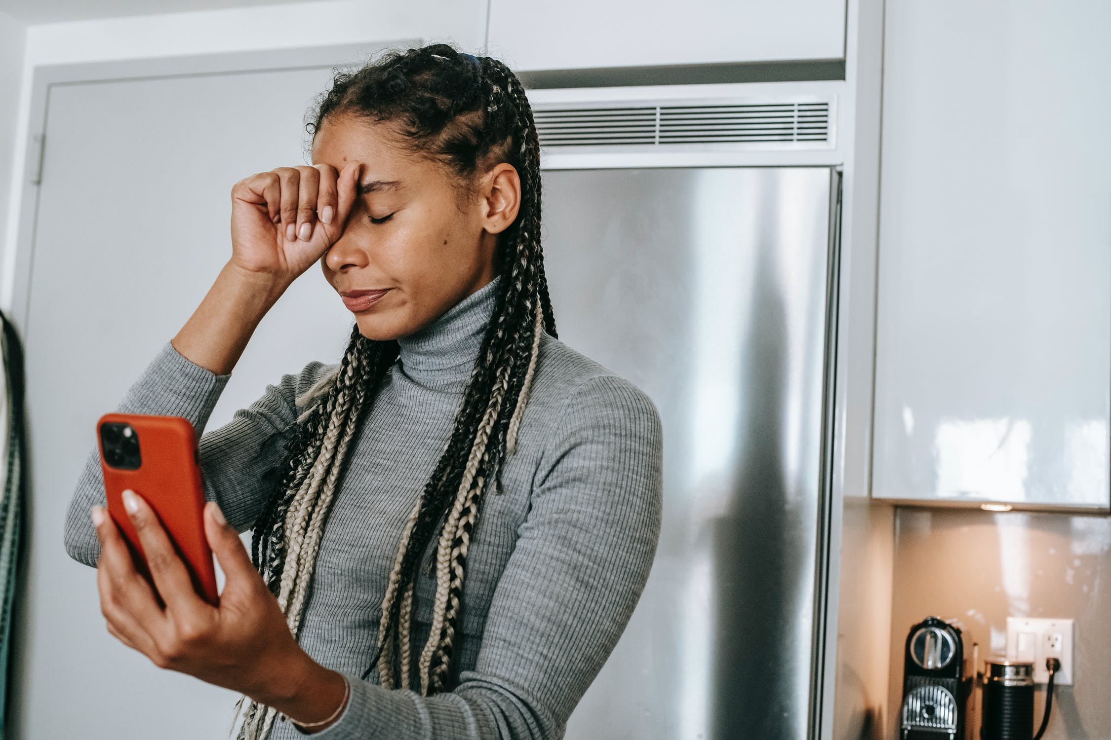 Woman looking frustrated on phone