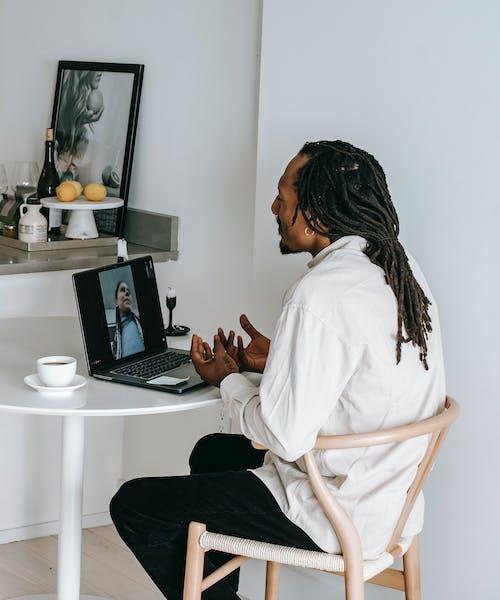 Black man having video call at home