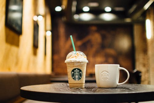 Close-Up Photo of Starbucks Cups