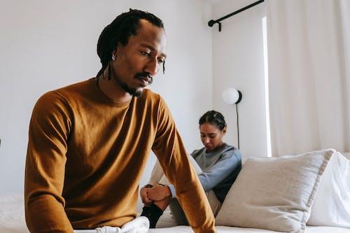 Upset black couple during dispute in bedroom