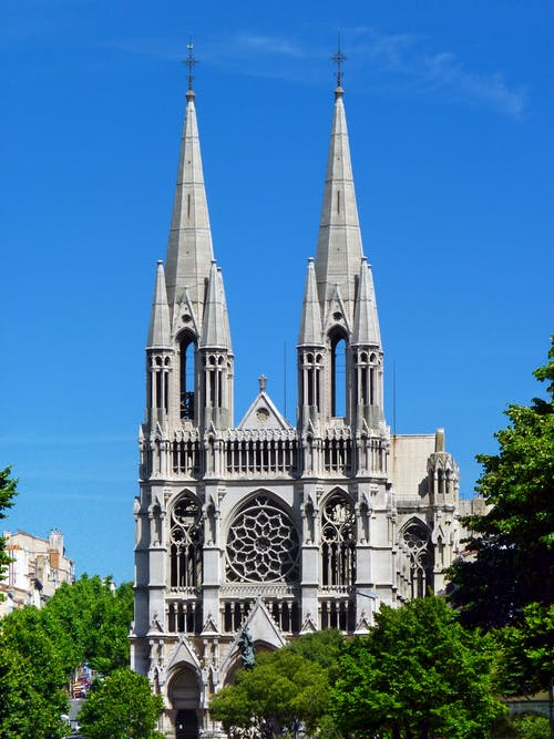 Old cathedral with spires against blue sky