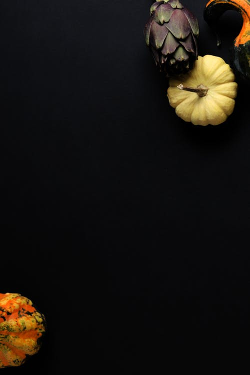Flatlay Photography of Pumpkins on Black Background