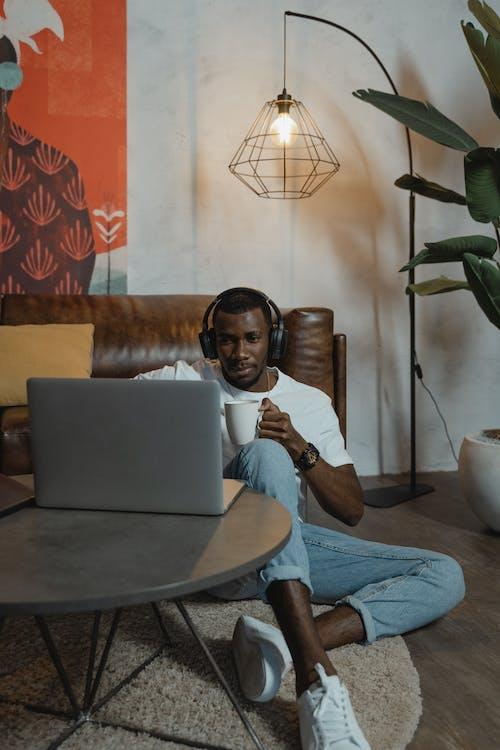 Man Using His Laptop while Having Coffee