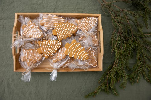 Brown Christmas Tree-Shaped Gingerbread Cookies in a Wooden Crate