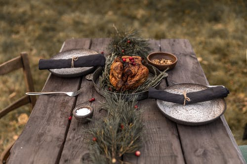 Cooked Turkey on Black Pan on Brown Wooden Table