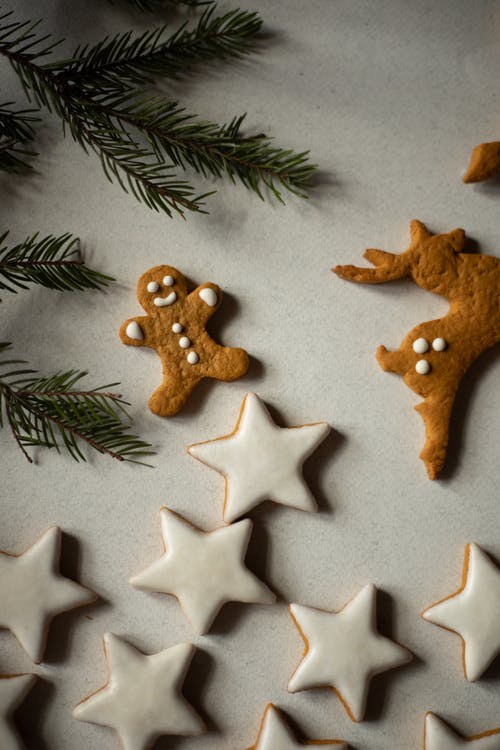 Brown Star Shaped Cookies on White and Green Leaves