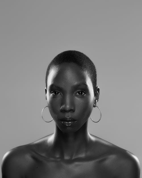 Topless black woman under studio light