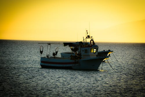 Free stock photo of boat, golden sunset, sea, sunset
