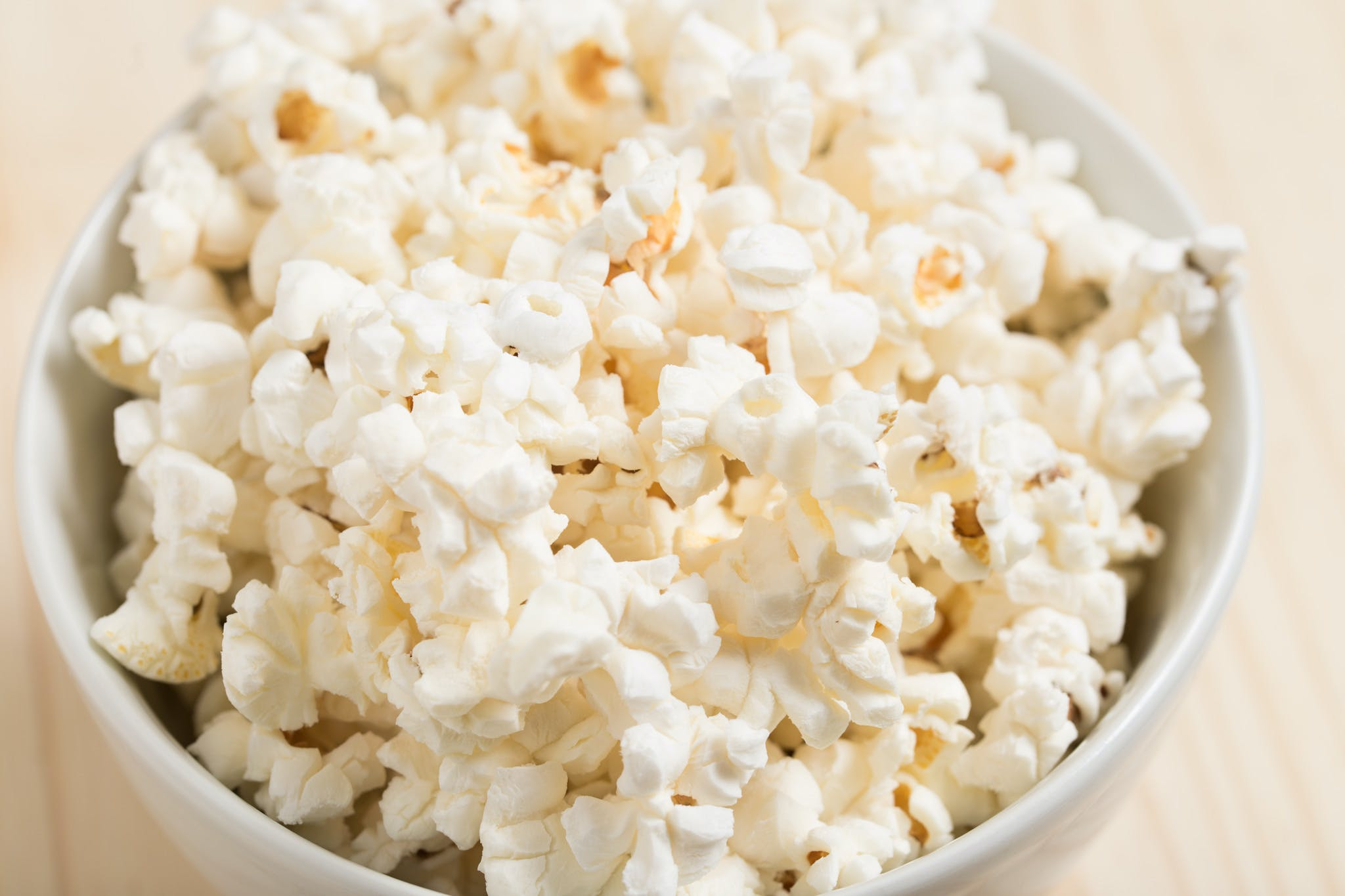 White Popcorns on Round White Ceramic Bowl
