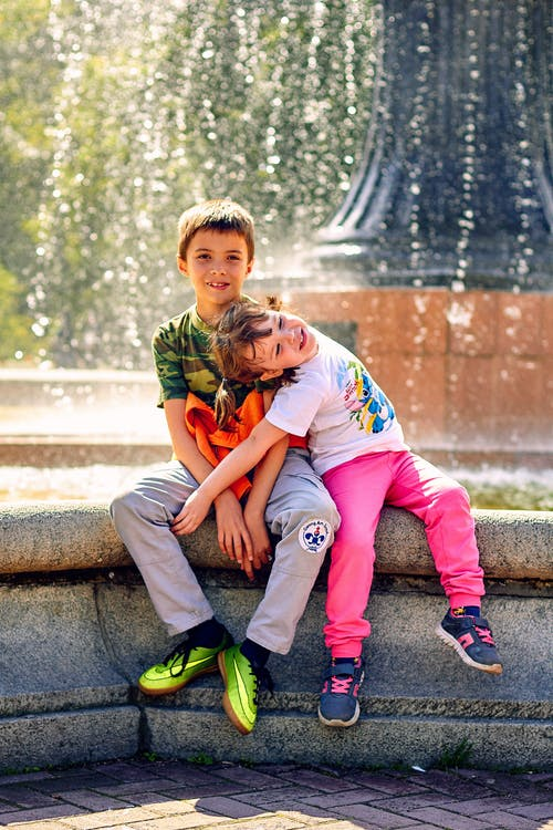 Children Sitting on the Fountain