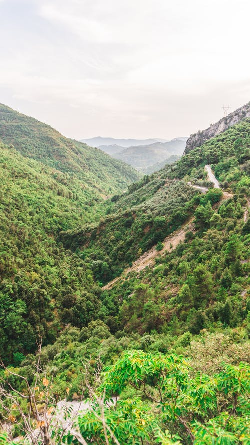 Green Mountains Under White Sky