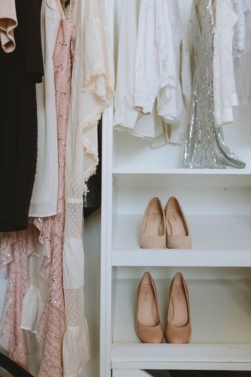Womens White Leather Flats on White Wooden Shelf