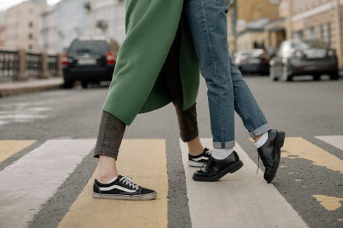 Person in Green Pants and Black and White Nike Sneakers