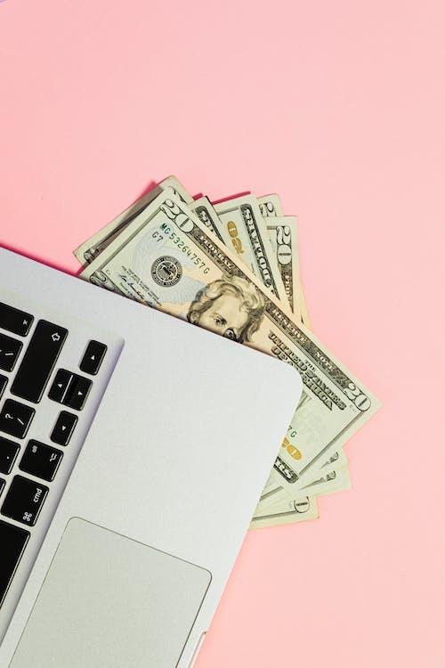 10 Us Dollar Bill Beside Macbook Pro