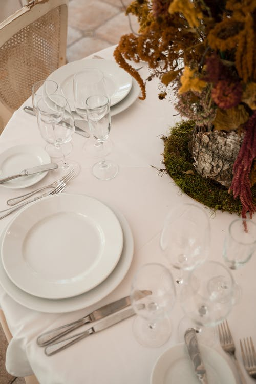 White Ceramic Plate and Clear Wine Glass on Table