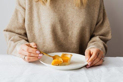 Person Getting Spoonful of Pumpkin Pie Dessert