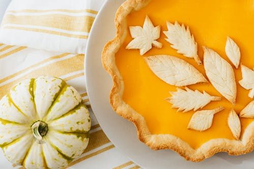 Baked Pumpkin Pie with Decorative Leafy Patterns Design