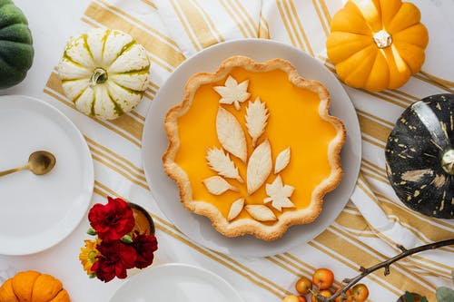 Delicious Pumpkin Pie on White and Yellow Fabric