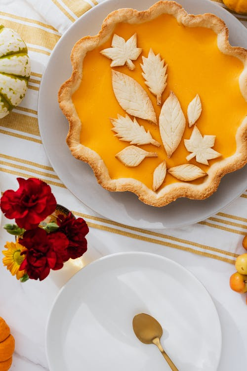 Delicious Pumpkin Pie with Leaf Patterns Decoration