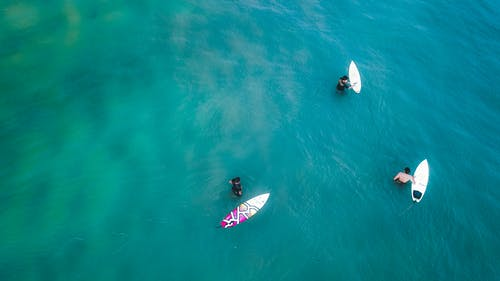 Surfers in clear turquoise lagoon