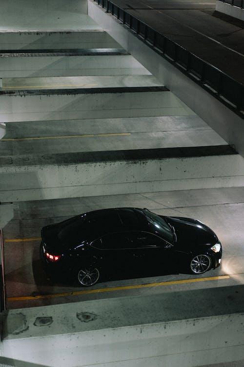 Black Porsche 911 Parked on Gray Concrete Stairs