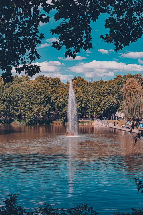 City park with fountain in sunlight