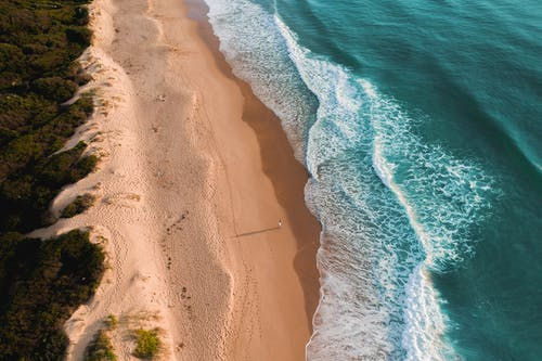 Turquoise water of sea washing sandy shore