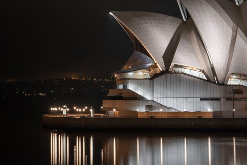 Exterior of futuristic Sydney Opera House at night