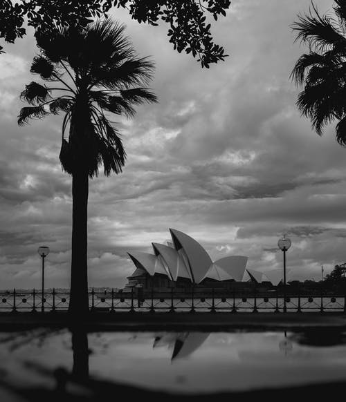 Majestic Sydney Opera House against city promenade