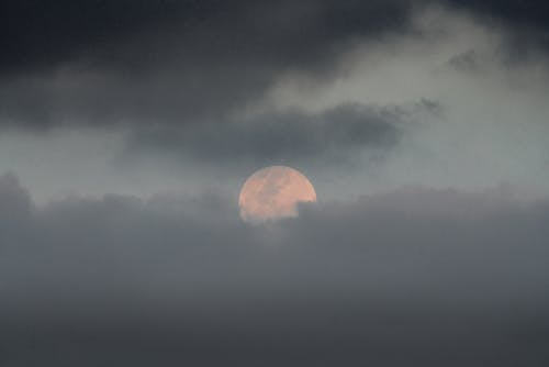 Moon on cloudy sky in evening