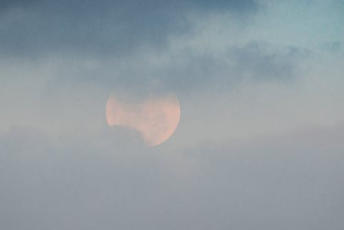 Moon shining on cloudy sky