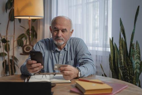 Man in Gray Dress Shirt Holding Black Ceramic Mug