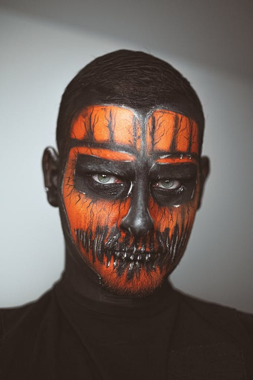 Male model with spooky Halloween mask