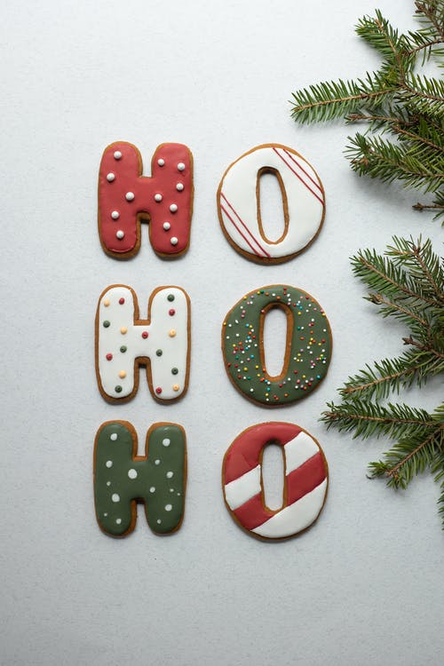 Ginger letter cookies composed with fir branch during Christmas holiday