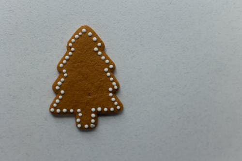 Tree shaped gingerbread placed on white background